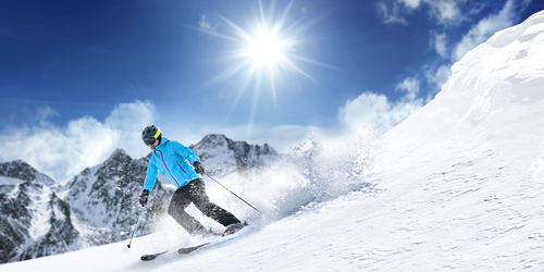 Image of Man Skiing Down Mountain