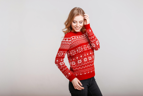 Image of woman wearing a red holiday sweater.