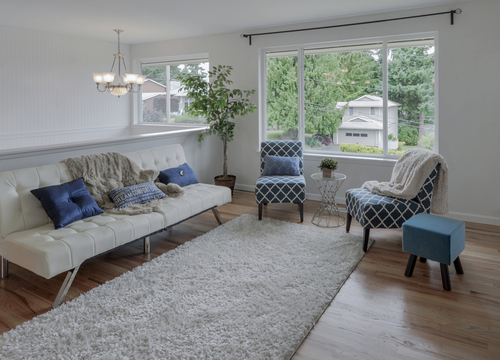 Image of a home living room with sofa, chairs and a shag area rug.