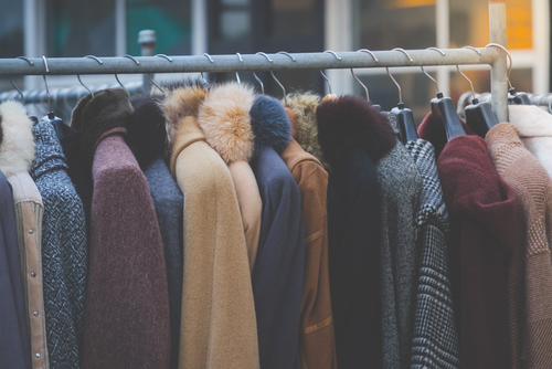 Image of Winter Coats on a Dry Cleaning Rack.