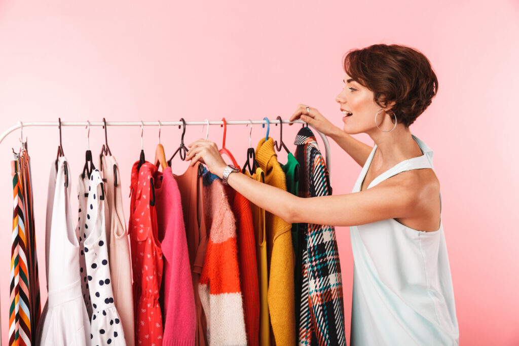 Woman looking through clothes on a rat